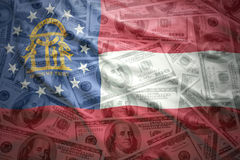 Colorful waving georgia state flag on a american dollar money background Stock Photography