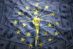 Colorful waving indiana state flag on a american dollar money background Royalty Free Stock Image