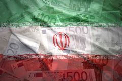 Colorful waving iranian flag on a euro  background Royalty Free Stock Photo