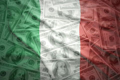 Colorful waving italian flag on a dollar money background. Colorful waving italian flag on a american dollar money background royalty free stock images
