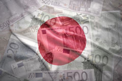 Colorful waving  japanese flag on a euro  background. Colorful waving  japanese flag on a euro money background Royalty Free Stock Photography