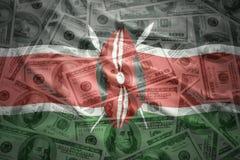 Colorful waving kenyan flag on a  dollar money background Royalty Free Stock Photo