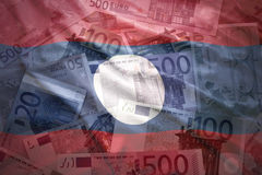 Colorful waving laotian flag on a euro  background Stock Images