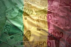 Colorful waving malian flag on a euro background. Colorful waving malian flag on a euro money background stock images