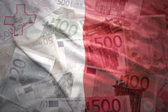 Colorful waving maltese flag on a euro  background. Colorful waving maltese flag on a euro money background Stock Photos