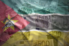 Colorful waving mozambican flag on a euro background Stock Photos
