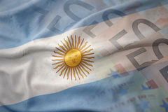 Colorful waving national flag of argentina on a euro money banknotes background. Stock Images