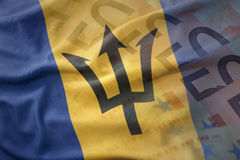 Colorful waving national flag of barbados on a euro money banknotes background. Stock Image