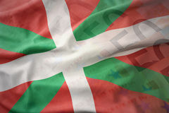 Colorful waving national flag of basque country on a euro money banknotes background. Finance concept Stock Image