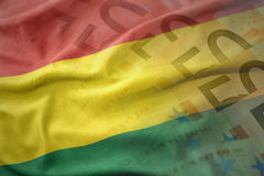 Colorful waving national flag of bolivia on a euro money banknotes background. Royalty Free Stock Photography