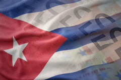 Colorful waving national flag of cuba on a euro money banknotes background. Royalty Free Stock Photography