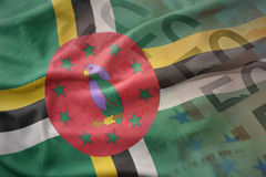 Colorful waving national flag of dominica on a euro money banknotes background. Royalty Free Stock Photography