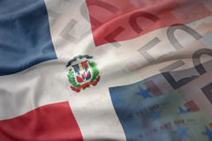 Colorful waving national flag of dominican republic on a euro money banknotes background. Royalty Free Stock Images