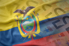 Colorful waving national flag of ecuador on a euro money banknotes background. Royalty Free Stock Images