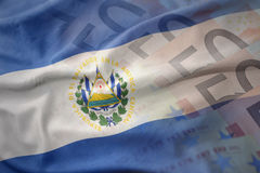 Colorful waving national flag of el salvador on a euro money banknotes background. Royalty Free Stock Photos