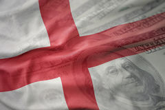Colorful waving national flag of england on a american dollar money background. Stock Photography