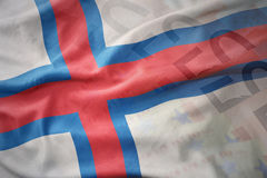 Colorful waving national flag of faroe islands on a euro money banknotes background. Royalty Free Stock Photos