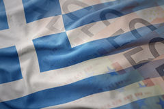 Colorful waving national flag of greece on a euro money banknotes background. Stock Photo