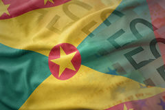 Colorful waving national flag of grenada on a euro money banknotes background. Stock Photos