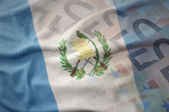 Colorful waving national flag of guatemala on a euro money banknotes background. Stock Photo