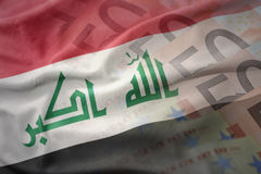 Colorful waving national flag of iraq on a euro money banknotes background. Stock Images