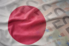 Colorful waving national flag of japan on a euro money banknotes background. Finance concept Royalty Free Stock Image