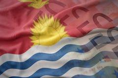 Colorful waving national flag of Kiribati on a euro money banknotes background. Stock Images