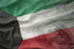 Colorful waving national flag of kuwait on a american dollar money background. Royalty Free Stock Photo