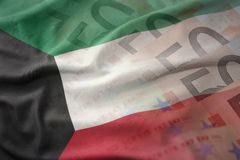 Colorful waving national flag of kuwait on a euro money banknotes background. Stock Photo