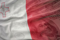 Colorful waving national flag of malta on a american dollar money background. Finance concept Royalty Free Stock Photo