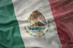 Colorful waving national flag of mexico on a american dollar money background. Finance concept royalty free stock photo