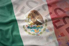 Colorful waving national flag of mexico on a euro money banknotes background. Royalty Free Stock Photo
