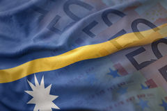 Colorful waving national flag of Nauru on a euro money banknotes background. Royalty Free Stock Photography