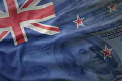Colorful waving national flag of new zealand on a american dollar money background. Stock Photo