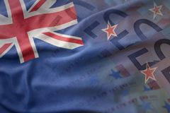 Colorful waving national flag of new zealand on a euro money banknotes background. Royalty Free Stock Photo