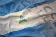Colorful waving national flag of nicaragua on a euro money banknotes background. Royalty Free Stock Photo