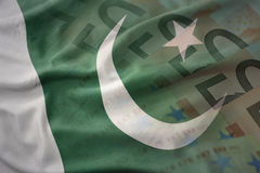 Colorful waving national flag of pakistan on a euro money banknotes background Royalty Free Stock Image