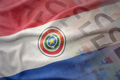 Colorful waving national flag of paraguay on a euro money banknotes background. Royalty Free Stock Photo