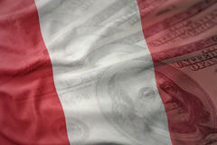 Colorful waving national flag of peru on a dollar money background. finance concept stock photo