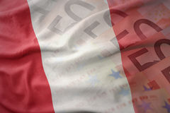 Colorful waving national flag of peru on a euro money banknotes background. Stock Photos