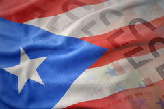 Colorful waving national flag of puerto rico on a euro money banknotes background. Royalty Free Stock Image