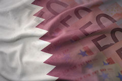 Colorful waving national flag of qatar on a euro money banknotes background. Stock Photo