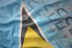 Colorful waving national flag of saint lucia on a euro money banknotes background. Stock Photography