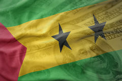 Colorful waving national flag of sao tome and principe on a american dollar money background. Finance concept Stock Photos