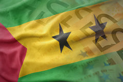 Colorful waving national flag of sao tome and principe on a euro money banknotes background. Finance concept Royalty Free Stock Image