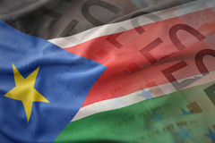 Colorful waving national flag of south sudan on a euro money banknotes background. stock photo