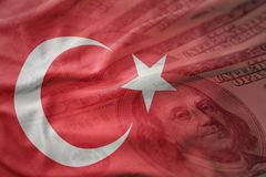 Colorful waving national flag of turkey on a american dollar money background. Stock Images