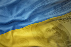 Colorful waving national flag of ukraine on a american dollar money background. Royalty Free Stock Photos