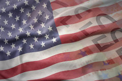 Colorful waving national flag of united states of america on a euro money banknotes background. Royalty Free Stock Photo