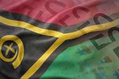 Colorful waving national flag of Vanuatu on a euro money banknotes background. Stock Photography